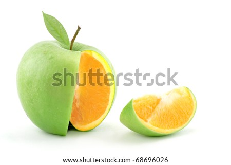 Sliced apple with genetically modified orange center - stock photo