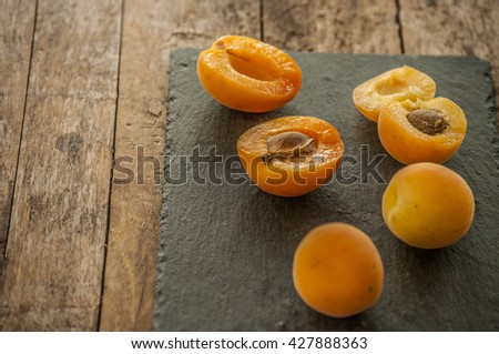 sliced apricots isolated on black background - stock photo