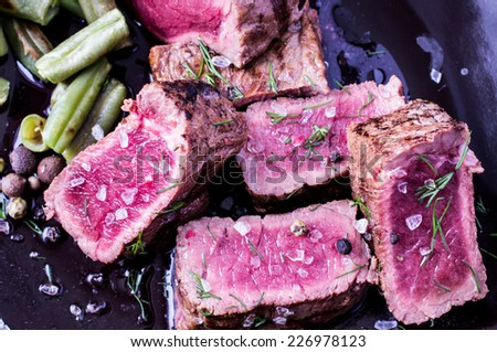 Sliced �¢??�¢??beef steak on a plate with beans - stock photo