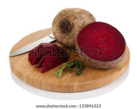 Sliced beetroot on board isolated on white - stock photo
