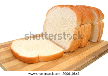 sliced bread isolated on wooden board  - stock photo