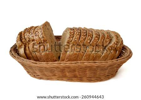 sliced bread lying in a wicker basket isolated on white background - stock photo