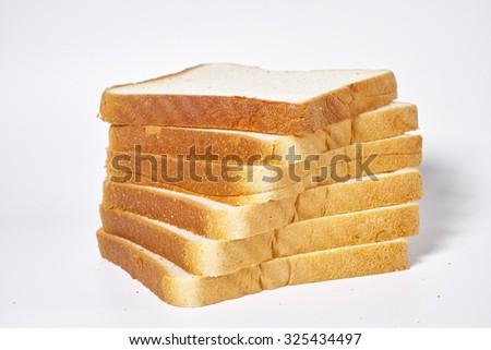 sliced bread on white background - stock photo
