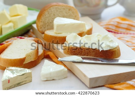 Sliced bread with cream cheese and butter for breakfast - stock photo