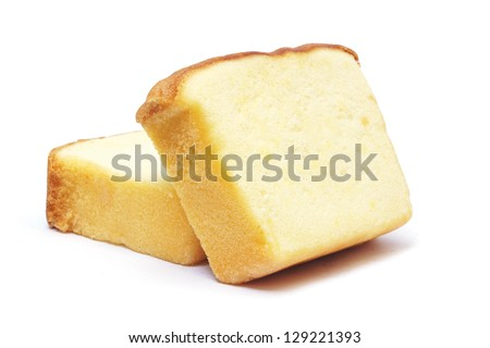 Sliced butter cake on white background - stock photo