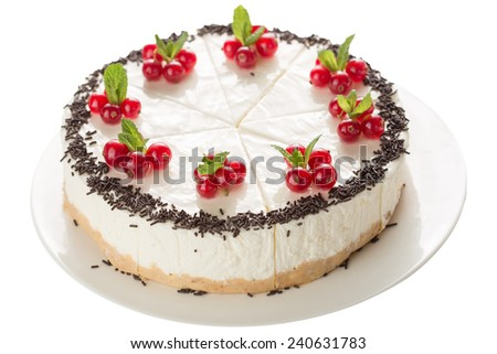 Sliced cake decorated with redcurrant and chocolate isolated on white background - stock photo