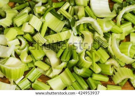 Sliced celery on the wooden board. Sliced celery, food background. - stock photo