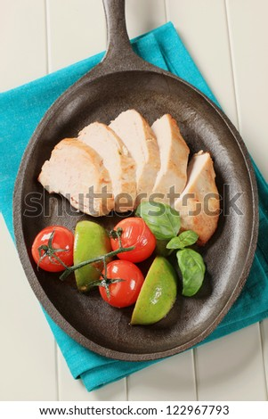 Sliced chicken breast on a skillet  - stock photo