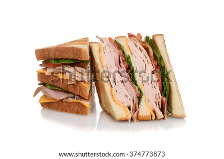 sliced chicken club sandwich - stock photo