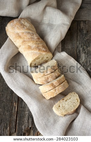 Sliced Ciabatta on wooden background - stock photo
