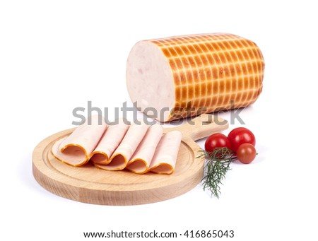Sliced Cooked turkey breast on cutting board with some Cherry tomatos on white background - stock photo
