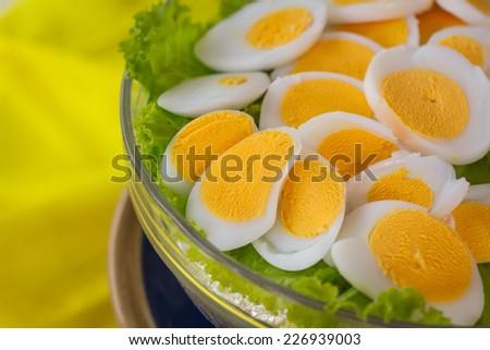 sliced  egg put in salad - stock photo
