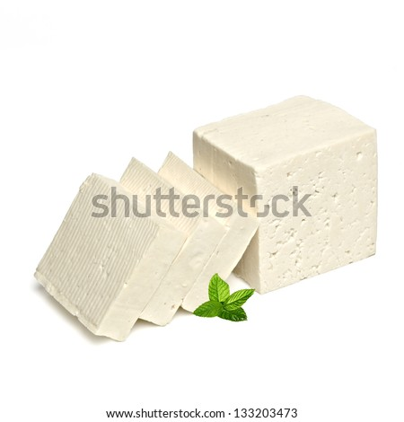 Sliced feta cheese with mint on white background - stock photo