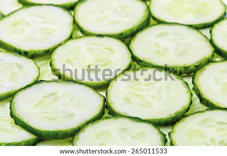 Sliced Fresh Cucumber background. Shallow depth of field, focus in the center of the frame - stock photo