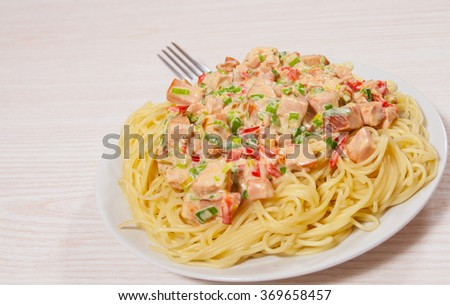 Sliced fried chicken fillet in a creamy sauce. with capellini pasta - stock photo
