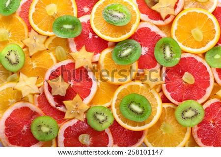 Sliced fruits background - stock photo