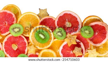 Sliced fruits isolated on white - stock photo