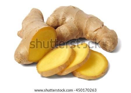 Sliced ginger root on white background - stock photo