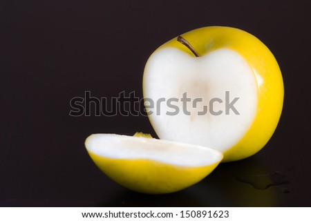Sliced �¢??�¢??golden apple on the wooden table. - stock photo
