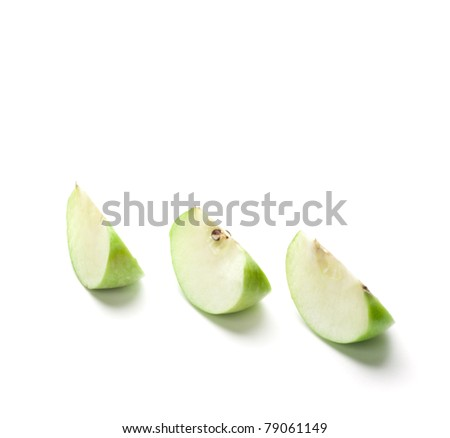 Sliced green apple on the white background - stock photo