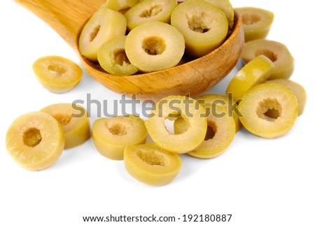 sliced green olives and wooden spoon isolated on the white background  - stock photo