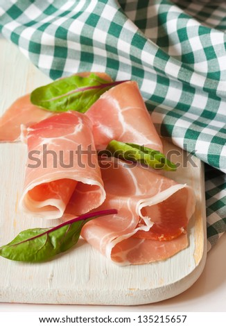Sliced ham on a white cutting board. - stock photo
