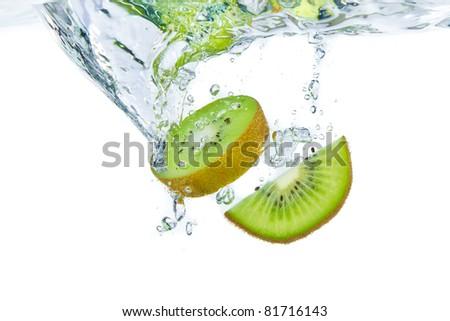 sliced kiwi fruit splashing isolated on white background - stock photo
