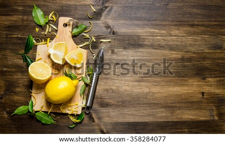 Sliced lemon on the Board with leaves. On a wooden table. Free space for text . Top view - stock photo