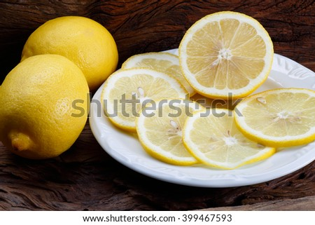 Sliced Lemon / Sliced Lemon / Sliced Lemon - stock photo