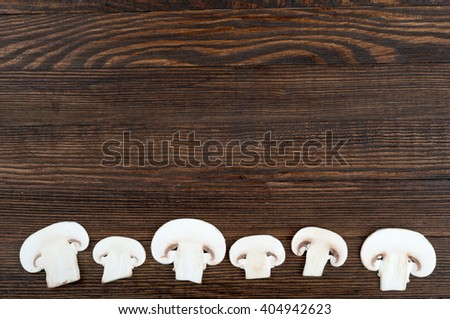 Sliced mushrooms on wooden rustic background with copy space. Food background. Top view  - stock photo