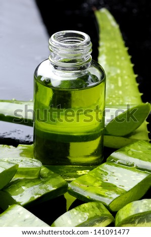 Sliced of aloe with lotion - stock photo
