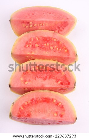 Sliced organic guava fruit. - stock photo