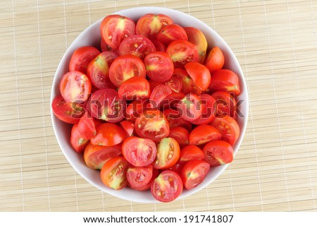 Sliced organic tomatoes in a bowl. - stock photo