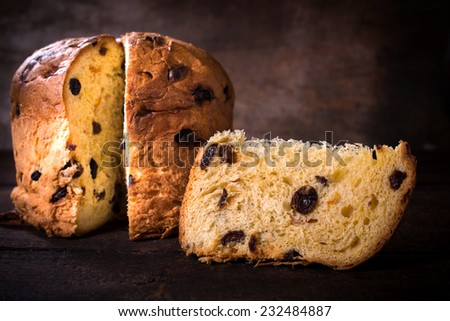 Sliced penatton cake on wooden background,selective focus  - stock photo