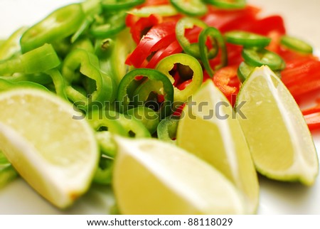 sliced peppers and limes - stock photo