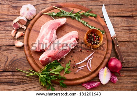 Sliced pieces of raw meat for barbe-que. Food, meat raw steak, beef steak bbq, spices for cooking meat. Free space for text.  - stock photo