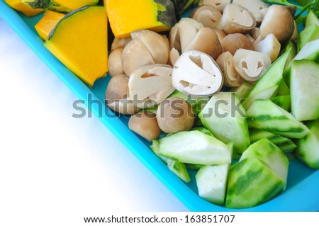 sliced pimpkin, ridge gourd and straw mushroom in a tray - stock photo