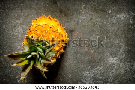 Sliced pineapple top view. On the stone table. Free space for text . Top view - stock photo