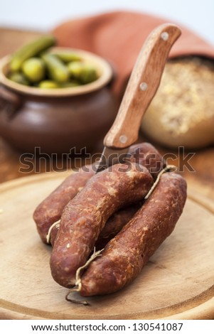 Sliced pork sausage on wooden table. - stock photo