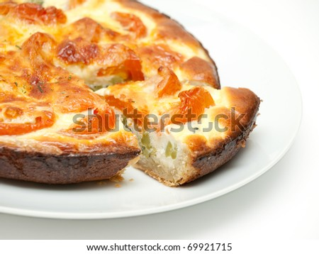 Sliced quiche on a plate - stock photo