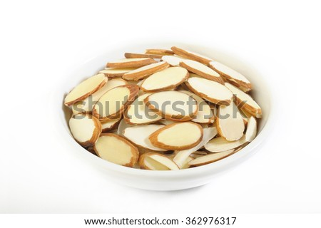 Sliced raw almonds in white bowl - stock photo