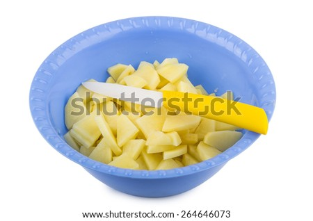 Sliced raw potatoes and knife in plastic bowl isolated on white background - stock photo