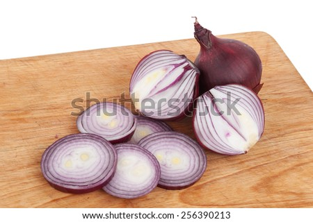 Sliced red onions on a wooden board - stock photo