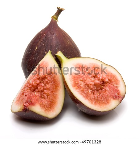 Sliced ripe figs from low viewpoint isolated against white background. - stock photo