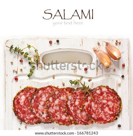 Sliced salami on a kitchen cutting board. - stock photo
