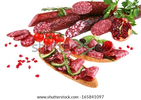 Sliced salami / studio photography of sliced food - isolated over white background  - stock photo