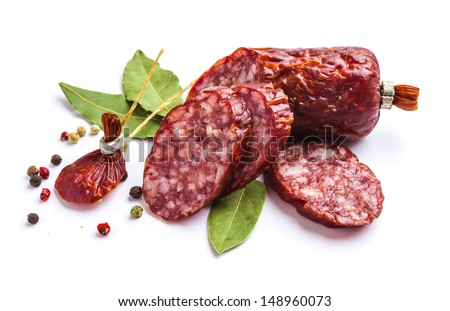 Sliced �¢??�¢??sausage with spices isolated on white background - stock photo