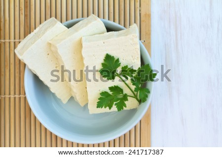 Sliced Tofu on a vintage wooden background  - stock photo