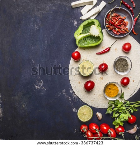 sliced vegetables on tortilla, Ingredients for cooking burritos border with text area on wooden rustic background top view  vertical - stock photo