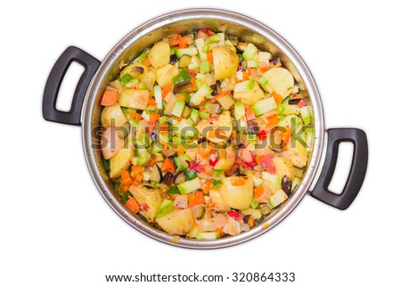 Sliced vegetables prepared for cooking a ratatouille in a stainless steel  saucepan. Top view on a white background. Isolation.  - stock photo